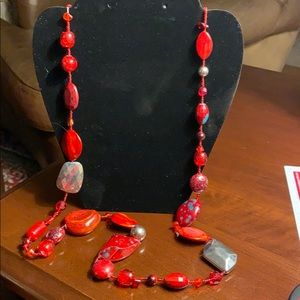 Long red colorful bead necklace.